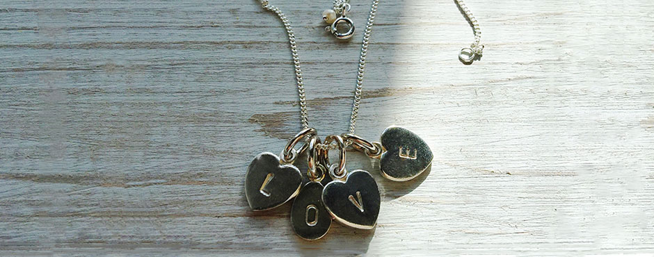 Stamped L O V E letter heart necklaces in Sterling Silver