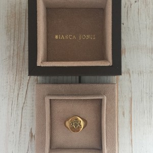 Fettesian Signet Ring shown in packaging