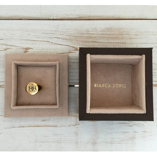 Fettesian Signet Ring shown in packaging