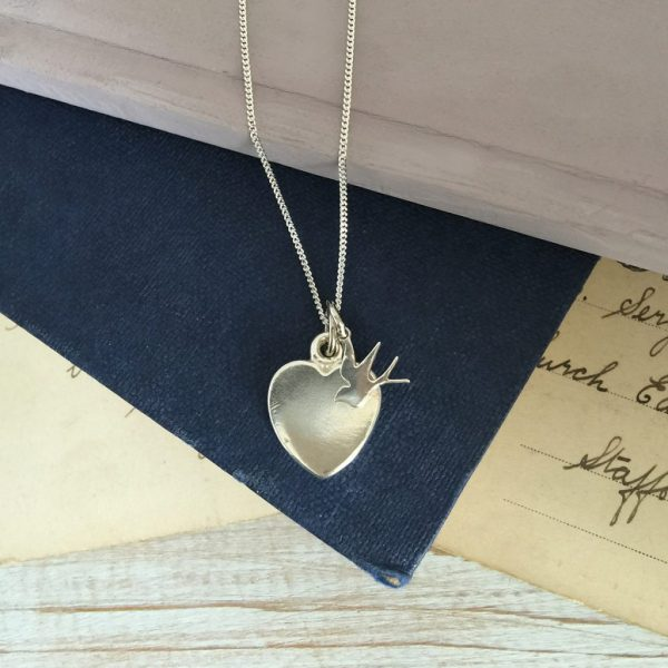 Large love heart and baby swallow necklace