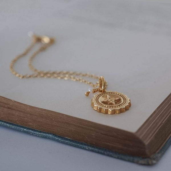 Compass with Pearl Bracelet