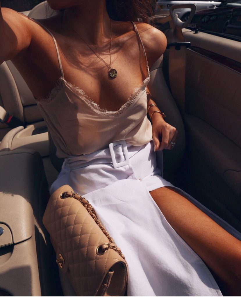 Lorna Luxe wearing her Compass necklace