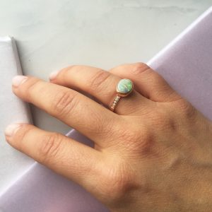 opal and rose gold gold ring set with diamonds
